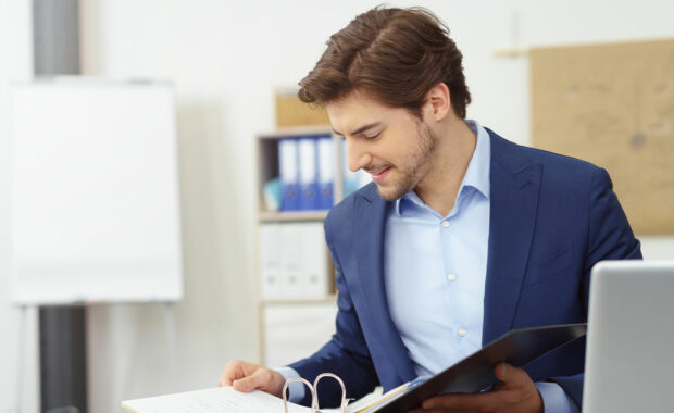 Man looking over files