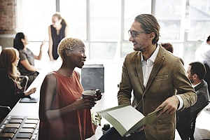 a business owner meeting with a benefits consultant to discuss workforce planning and assessments