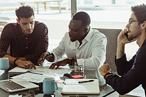 business owners speaking with an employee benefits consultant