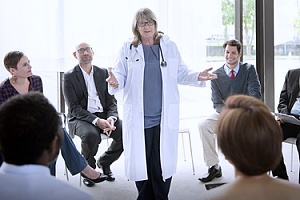 a doctor discussing managed healthcare plans with an organization