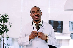 a doctor who sees patients through several managed healthcare plans