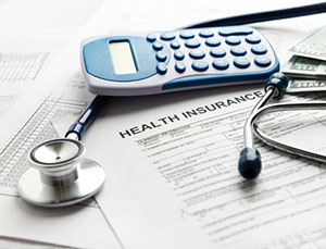 Self funding health insurance paperwork on desk