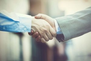 handshake between a benefits consultant and the CEO of a company