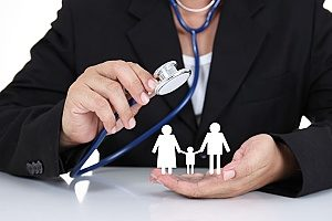 a doctor holding a stethoscope over paper cutouts of a 3 person family symbolizing how self funding insurance works