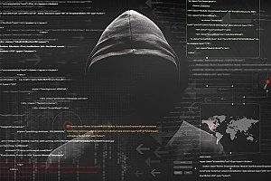 a man with a hooded jacket shown behind lines of code which show an imminent cyber attack on a small business