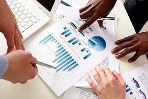 data charts and graphs that benefits consultants are reviewing to monitor the activity of employees and make sure they are following the strategic planning process of the business