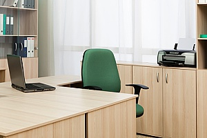an empty desk for an individual with employee benefits who is taking leave