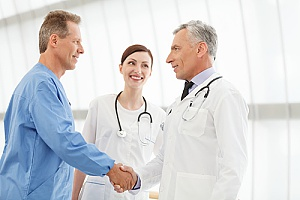 a business employee shaking hands with a doctor before a visit