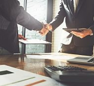 a handshake between two new business partners