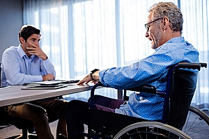 a business partner who is now in a wheelchair and will receive disability buy out