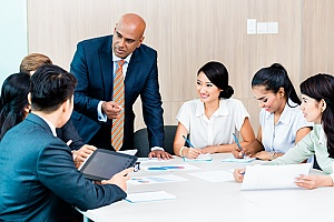 a group of business executives conducting executive planning