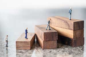 figurines walking up blocks representing succession planning