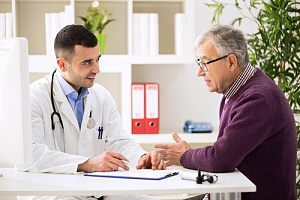 physician talking to patient that needs to cut health care costs with primary care
