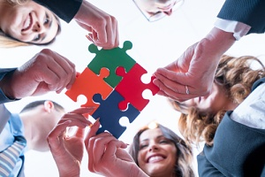 employees coming together after acquiring benefit consulting services
