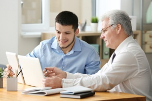 male employees doing open enrollment communication strategies