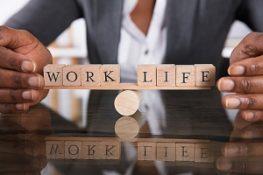 Close shot of businesswoman hands surrounding work life balance