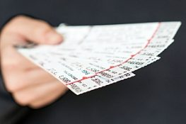 Tickets held in hand being offered