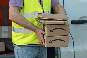 Amazon employee holding boxes