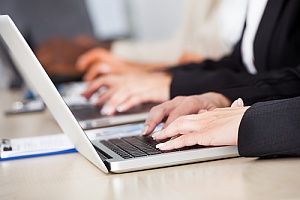 Employee with hands on laptop