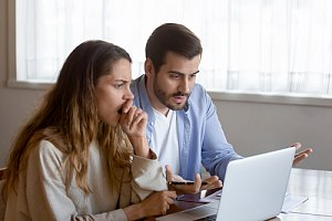 Couple going over unexpected balance billing