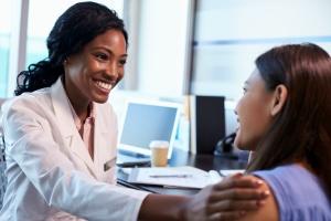 women doctor talking with patient