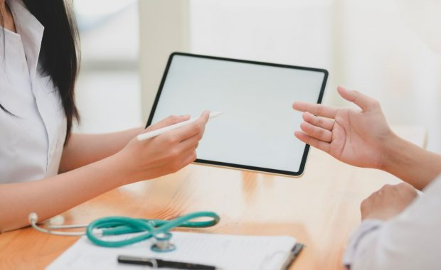 a doctor discussing medical billing with a patient