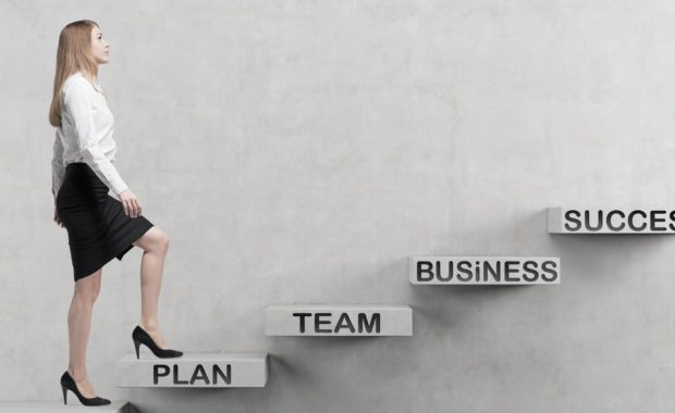 Young business woman is going up to the stairs. A concept of Disability buy-out insurance in a business succession plan