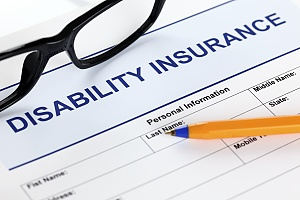 a disability insurance application with glasses and a pencil that will be filled out by a business