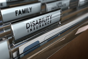 paper files with the words disability insurance on them in a file folder cabinet