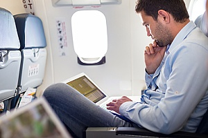 a business executive traveling internationally on a plane