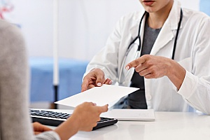 a doctor prescribing medicine to a business woman who will be working abroad