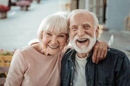 elderly couple smiling while being in a great mood. Short-term disability insurance policies protect employees