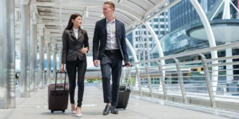 two business owners traveling with international health insurance plans