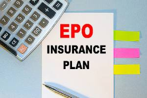 A notepad with EPO insurance plan written on it, multicolored stickers, a calculator and a pen