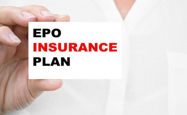 A woman holds a card that has EPO INSURANCE PLAN written on it