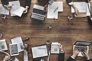 Business team Meeting. Streamlining benefits renewal process can prevent any costly surprises