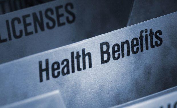 Filing folder featuring health benefits tab. Benefits renewal process involves completing a benefits renewal survey