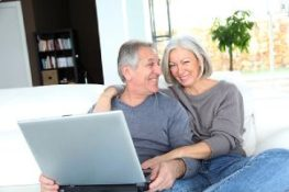 Happy Senior couple sitting on a sofa. EPO insurance plan lower health care costs than other plans