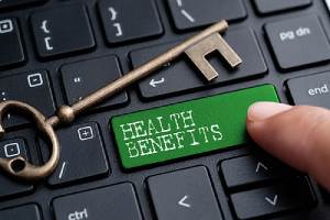 Keyboard button with word health benefits. Benefits renewal process include reviewing employment benefit plans