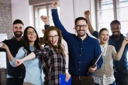 A group of happy employees. Benefits renewal is not always simple