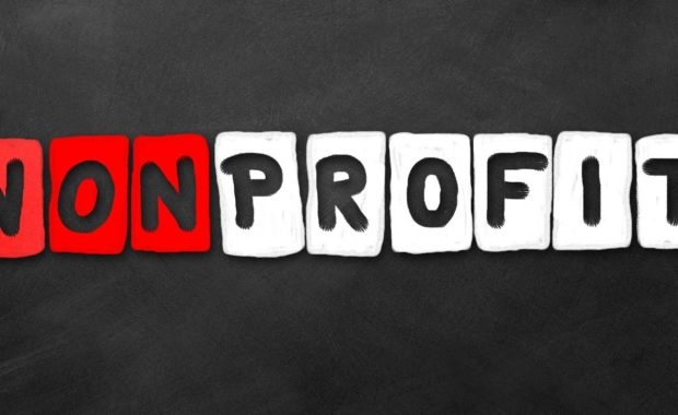 Nonprofit word on a dark background. Nonprofit organizations need directors and officers insurance