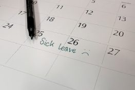Marking sick leave on calendar. Employee benefits packages can attract new talent and retain existing staff