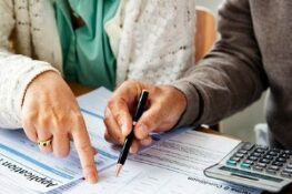 Couple Filling Insurance Form