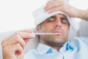 Sick Office Employee Taking Thermometer Reading
