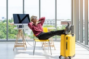 Employee Ready for Vacation with Yellow Suitcase