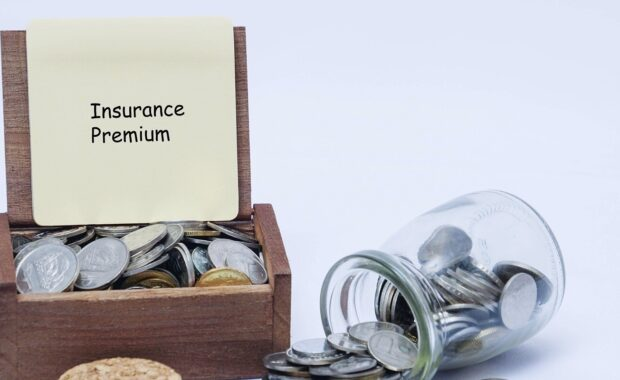 What Is Insurance Premium Financing- Insurance Premium Board with Coins in Jar