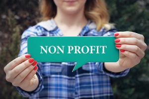 Woman holding Non profit speech balloon. Most nonprofit organizations recognize the need to carry EPLI