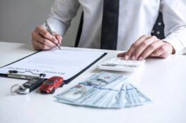 Man Calculating Insurance Premiums