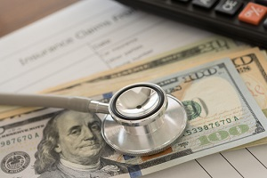 stethoscope currency notes and medical chart