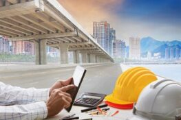 civil engineer working table and urban building with infrastructure development